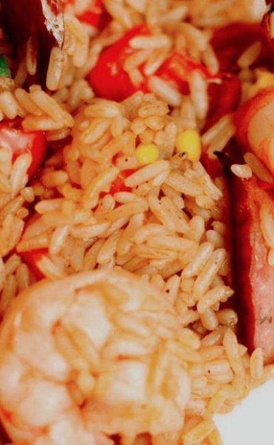 LIBERIAN JOLLOF RICE 1 (2 - 2 1/2 lbs.) chicken 1 lb. stewing beef 1 lb. smoked ham or bacon 2 onions 1 can tomato paste 1 c. cooking oil 1 pkg. frozen mixed vegetables 3 c. rice Salt black pepper